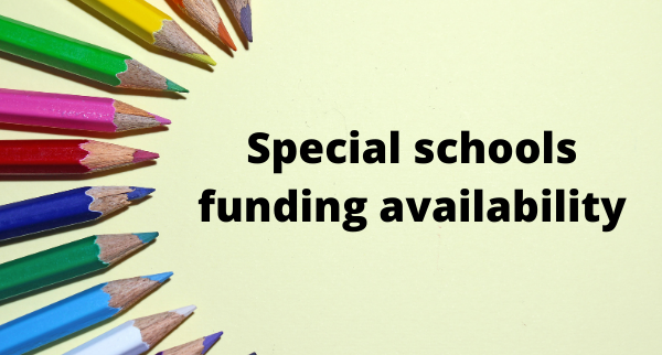 Colouring pencils arranged to point at the message, 'Special school funding available'